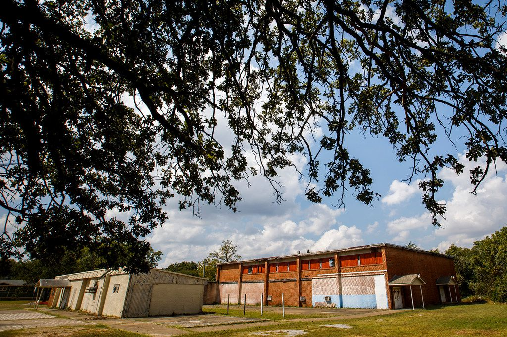 The former all-black school in Joppa, which Habitat for Humanity now owns and is trying to determine what to do with, served as a church before it was shuttered and padlocked.