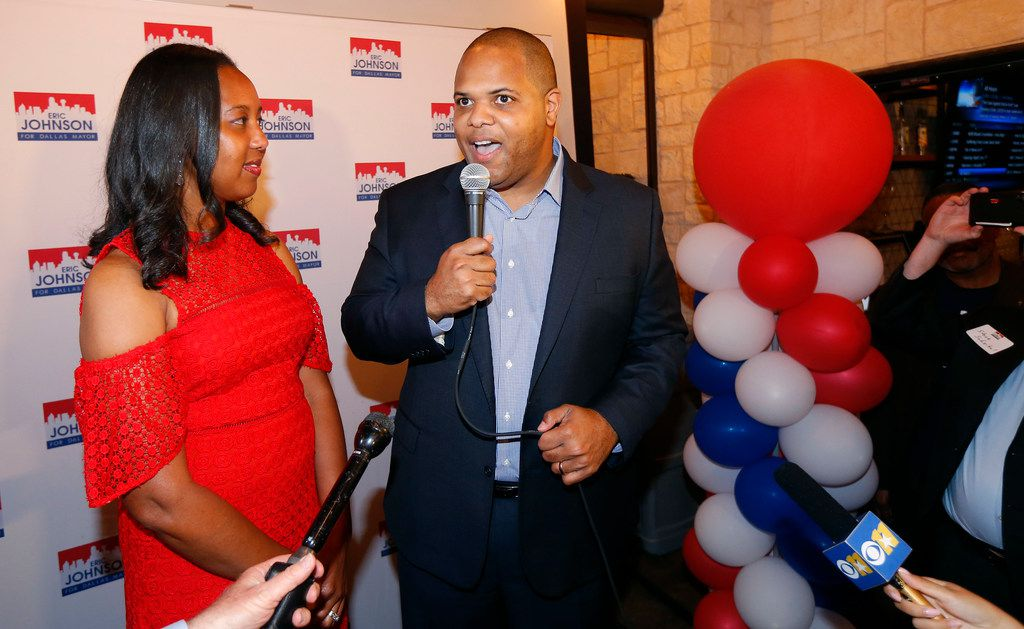 Dallas mayoral candidate Rep. Eric Johnson (right) delivers remarks on his early voting success alongside his wife Nakita Johnson at Smoky Rose restaurant in Dallas on May 4, 2019. (Tom Fox/The Dallas Morning News)