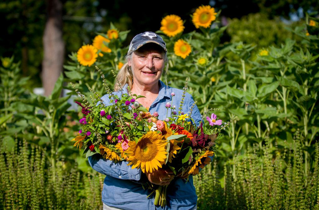 Amanda Vanhoozier of Bishop Hill Farm with a fresh bouquet of cut flowers from her Coppell garden.