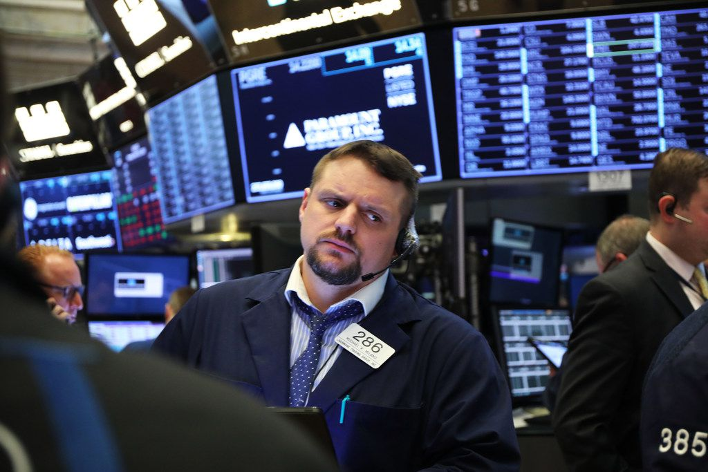 Traders work on the floor of the New York Stock Exchange on March 25.