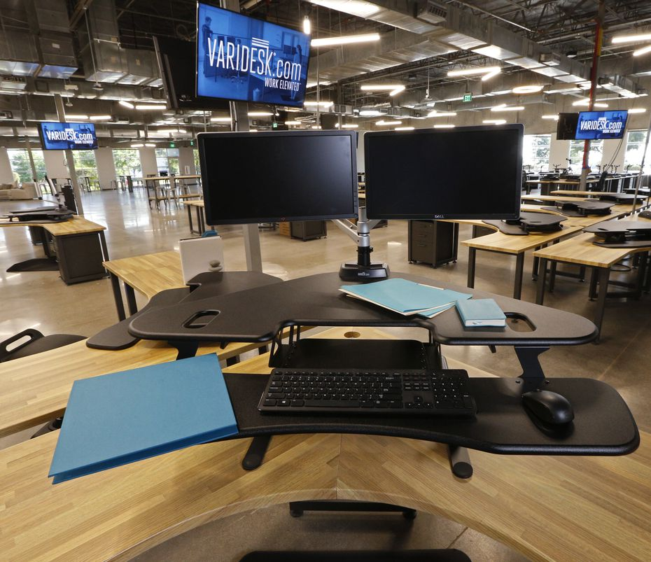 A Varidesk desk that allows you to stand or sit.  (Nathan Hunsinger/Staff Photographer)