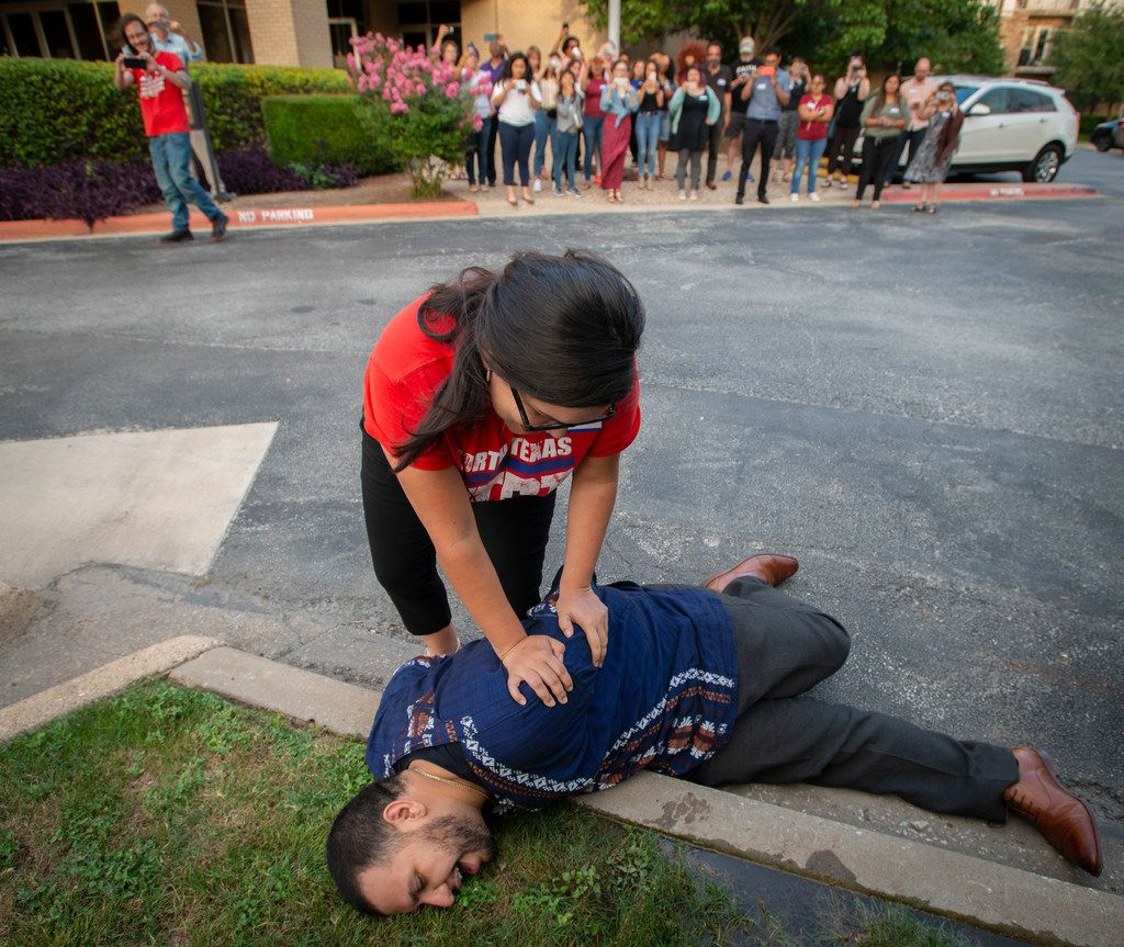 Angelica Andrade and Nicolas Hernandez of the North Texas Dream Team simulated an arrest in Dallas on June 26 for a group of volunteers who were undergoing training for rapid mobilization in case of immigration raids in the area.