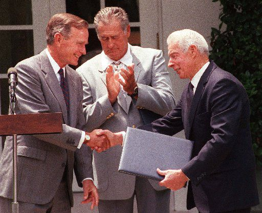 """President George Bush presented Presidential Citations """"for their contributions to baseball and sportsmanship"""" to Hall of Famers Joe DiMaggio (right) and Ted Williams during a Rose Garden ceremony at the White House on July 9, 1991."""