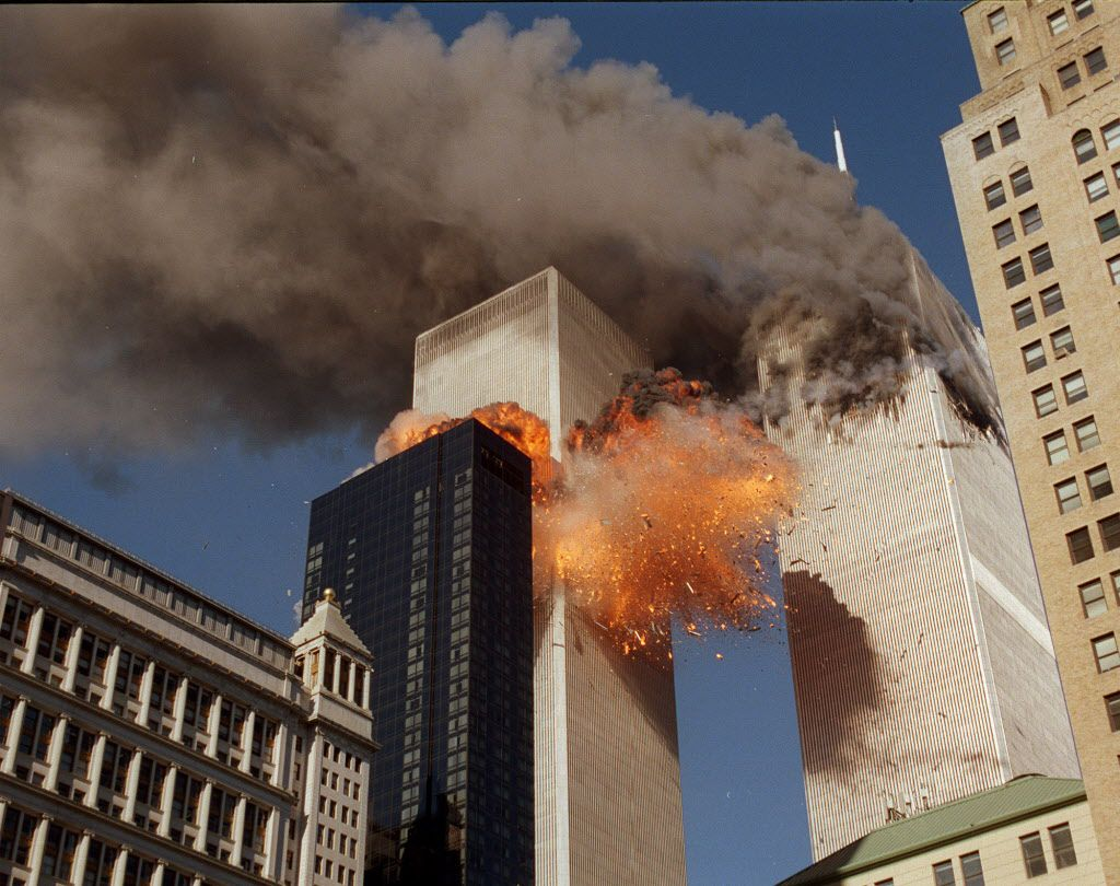 Smoke and flames streamed out of the World Trade Center towers on Sept. 11, 2001. (Chao Soi Cheong/The Associated Press)