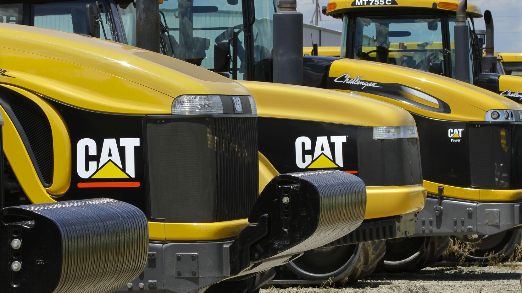 FILE - In this Wednesday, June 20, 2012, file photo, shows Caterpillar logos on earth moving tractors and equipment in Clinton, Ill. Caterpillar laid off 120 workers in Victoria this month. Caterpillar Inc. is the worlds largest construction and mining equipment maker, so its results are watched closely as a sign of where the broader economy is headed. (AP Photo/Seth Perlman)