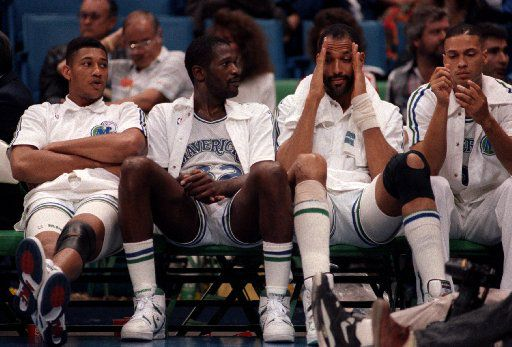 ORG XMIT: S0354653734_STAFF 05/01/90-- Dallas Mavericks player, from left, Randy White (33), Herb Williams (32), James Donaldson (40), and Anthony Jones (21) sit in dejection on bench during the Mavericks game against the Portland Trailblazers on May 1, 1990, the last NBA playoff game at Reunion Arena.