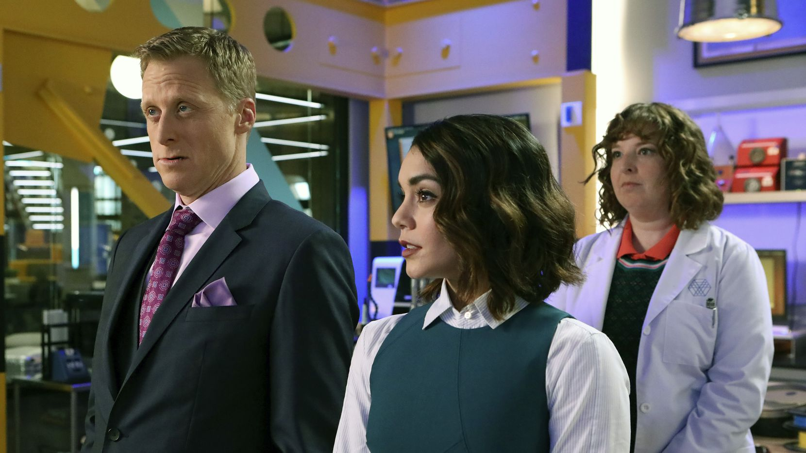 Alan Tudyk plays Van Wayne, cousin of Bruce Wayne (aka Batman). He runs Wayne Securities, which tries to protect regular citizens from the collateral damage inflicted from superhero fights. Vanessa Hudgens plays new employee Emily and Jennie Pierson is Wendy, a lead engineer.