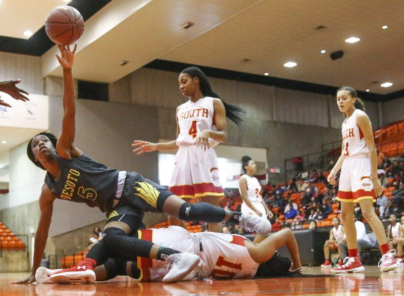 DeSoto guard Bria Patterson (5) falls on South Grand Prairie guard Kamryn Arrington (10) during a Class 6A Region I women basketball game at Wilkerson-Greines Activity Center in Fort Worth, Texas on Saturday, Feb. 23, 2019. (Shaban Athuman/The Dallas Morning News)