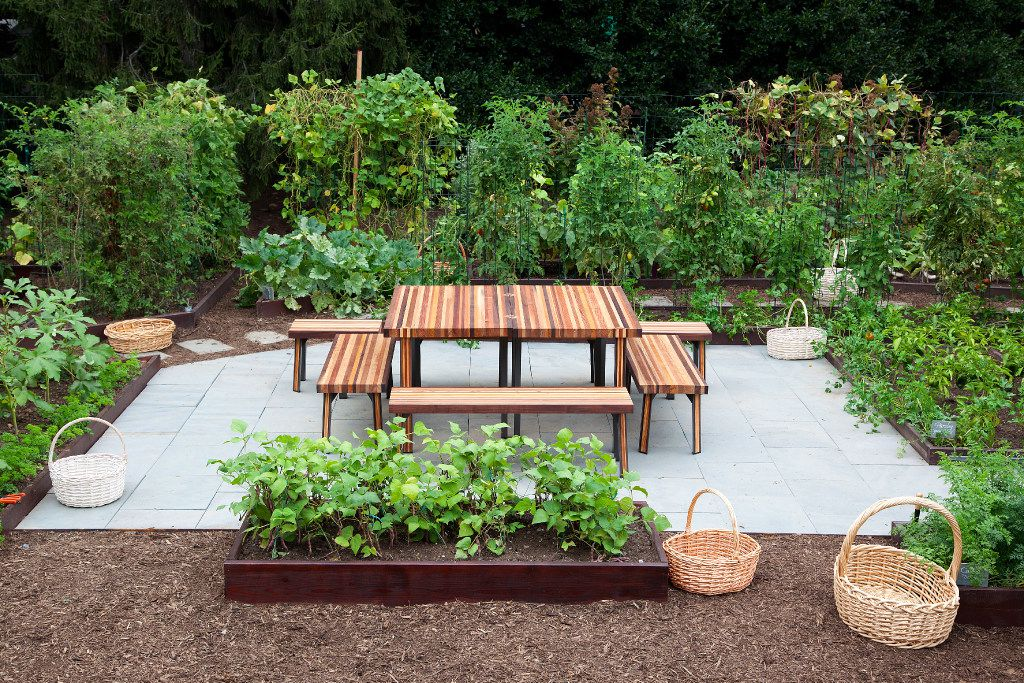 A  communal table anchors the gathering place in the middle of the White House Kitchen Garden in Washington, D.C.