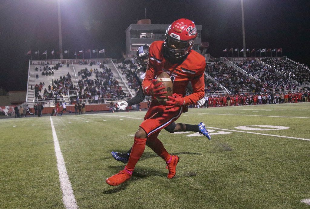 Cedar Hill wide receiver Jalen Hollins (11) hauls in a pass Mansfield Summit player Ahmaad Moses (23) during the first half of a high school football game between Cedar HIll and Mansfield Summit on Friday, October 11, 2019 at Longhorn Stadium in Cedar Hill, Texas. (Shaban Athuman/Staff Photographer)
