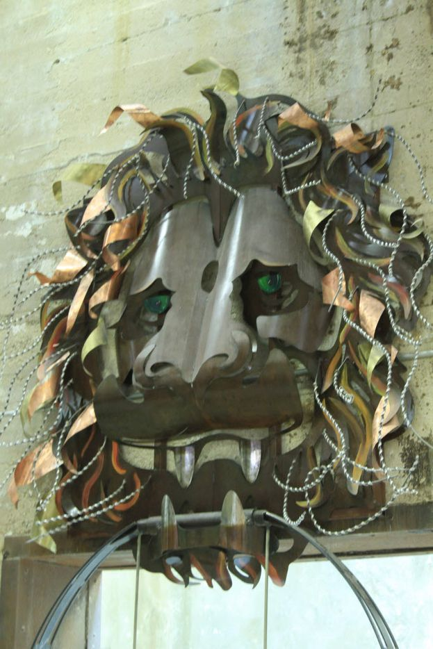 The oversized Lion Head Door Knocker Swing was created by Bryon Zarrabi, James Bauer and Pascale Pryor, based on a concept drawing by Rolando Diaz.  Miniature mock-ups, with various modifications from the original sketch, hang next to the large sculpture to illustrate the iterative and collaborative nature of the creative process.