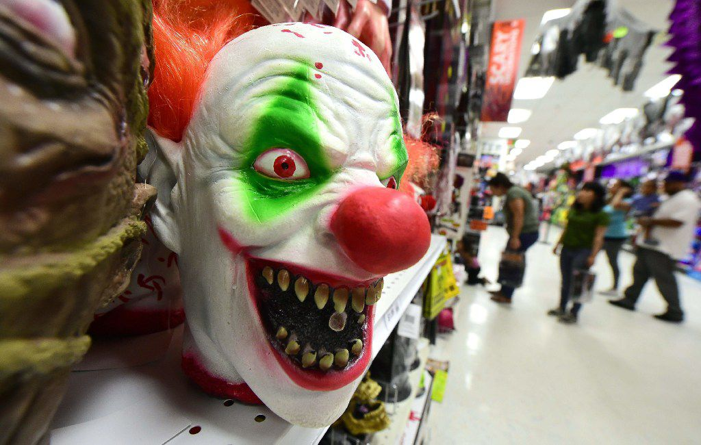 Clown masks are displayed and for sale at a shop selling Halloween items in Alhambra, California on October 21, 2016.  According to the National Retail Federation more than 171 million Americans will celebrate Halloween this year, with total spending expected to reach $8.4 billion, an all-time high in the history of NRF's annual survey conducted by Prosper Insights. / AFP PHOTO / Frederic J. BROWNFREDERIC J. BROWN/AFP/Getty Images