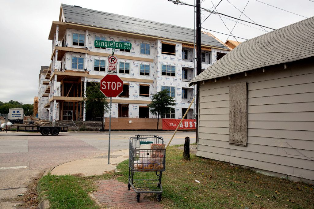 Apartments under construction at the intersection of Singleton Boulevard and Crossman Avenue show the gentrifying change coming to West Dallas. (G.J. McCarthy/Staff Photographer)