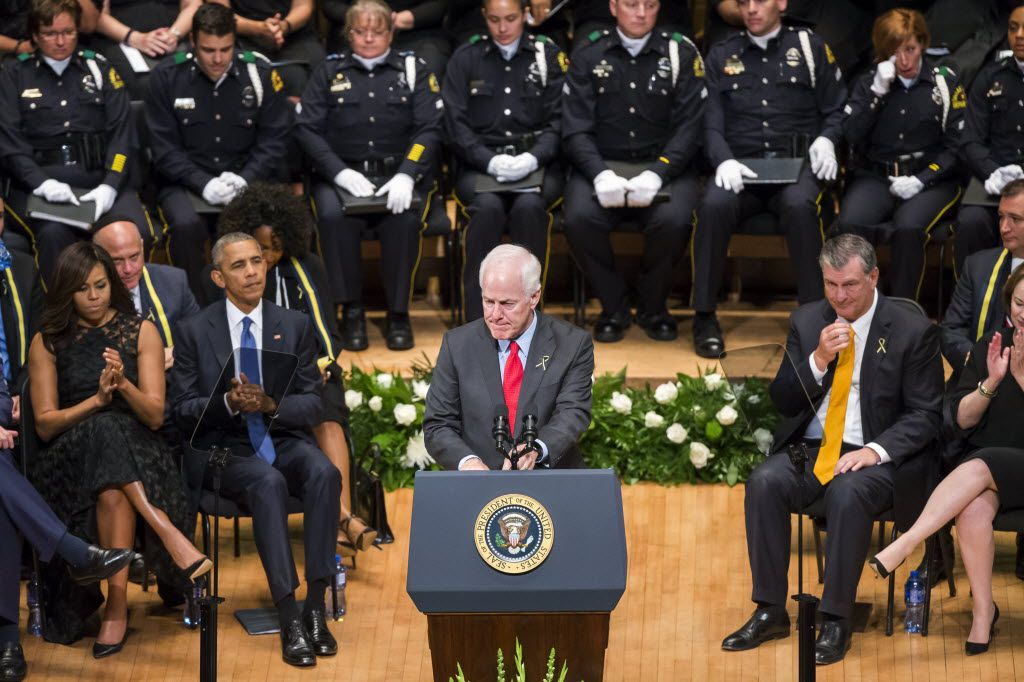 Sen. John Cornyn speaks during an interfaith memorial service at the Morton H. Meyerson Symphony Center on Tuesday in Dallas, honoring five law enforcement officers killed last week in an ambush at a Black Lives Matter rally.