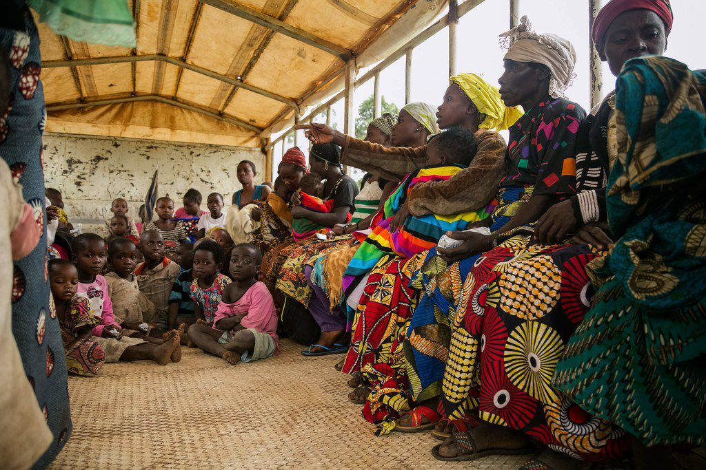 Congolese who crossed the border from the Democratic Republic of Congo wait to be registered as refugees at the Nyakabande transit center in the village of Nyakabande in western Uganda.  Since December, about 300 Congolese per day have been fleeing from the Mai Mai militia's attacks in the Kivu region of the eastern part of DRC to this border area.