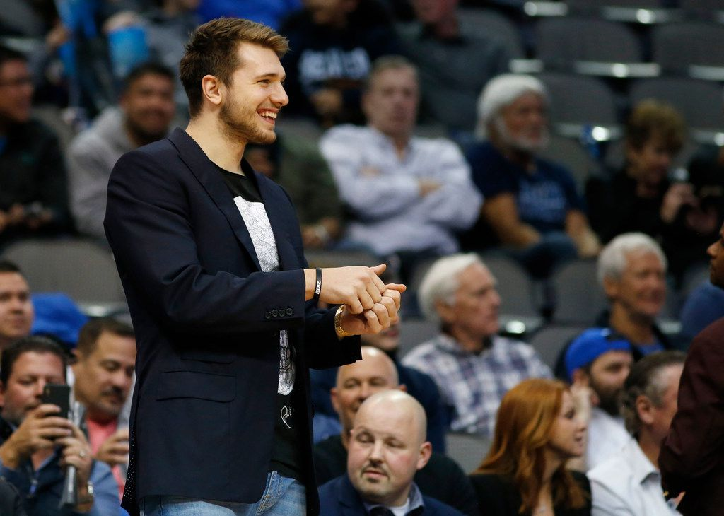Dallas Mavericks forward Luka Doncic (77) smiles from the bench as he watches during the second half of play at the American Airlines Center in Dallas on Monday, April 1, 2019. Dallas Mavericks defeated the Philadelphia 76ers 122-102. (Vernon Bryant/The Dallas Morning News)