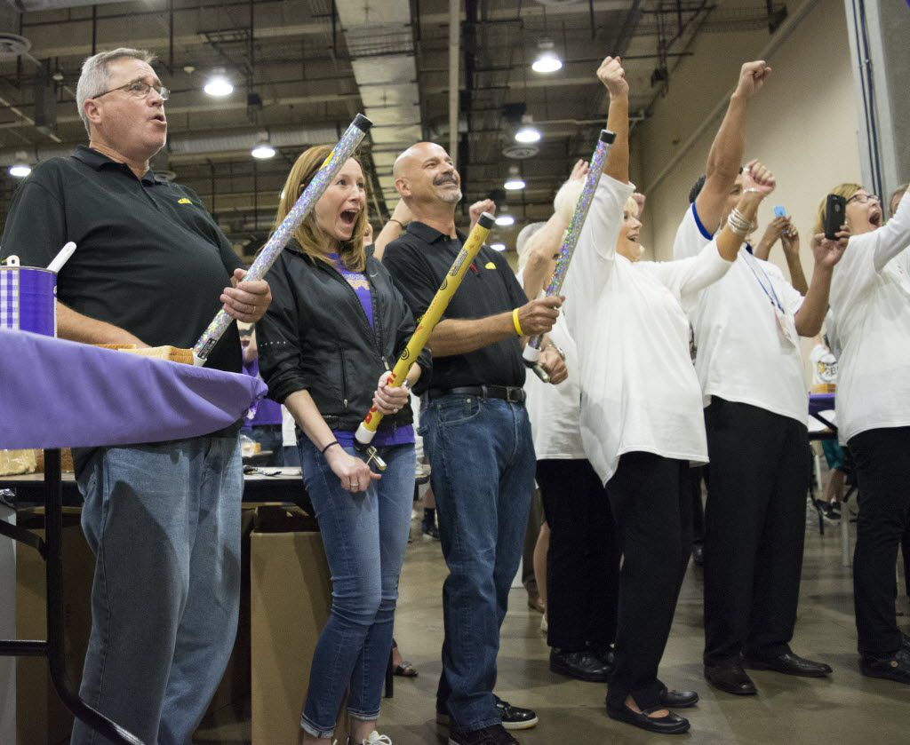 Which Wich employees Bobby Marek, Amanda Clayton and Don Laskey prepare to pull on confetti cannons as Guinness World Records Official Michael Empric announces that they have broken the world record for the highest number of PB&J sandwiches made in one room in one hour.