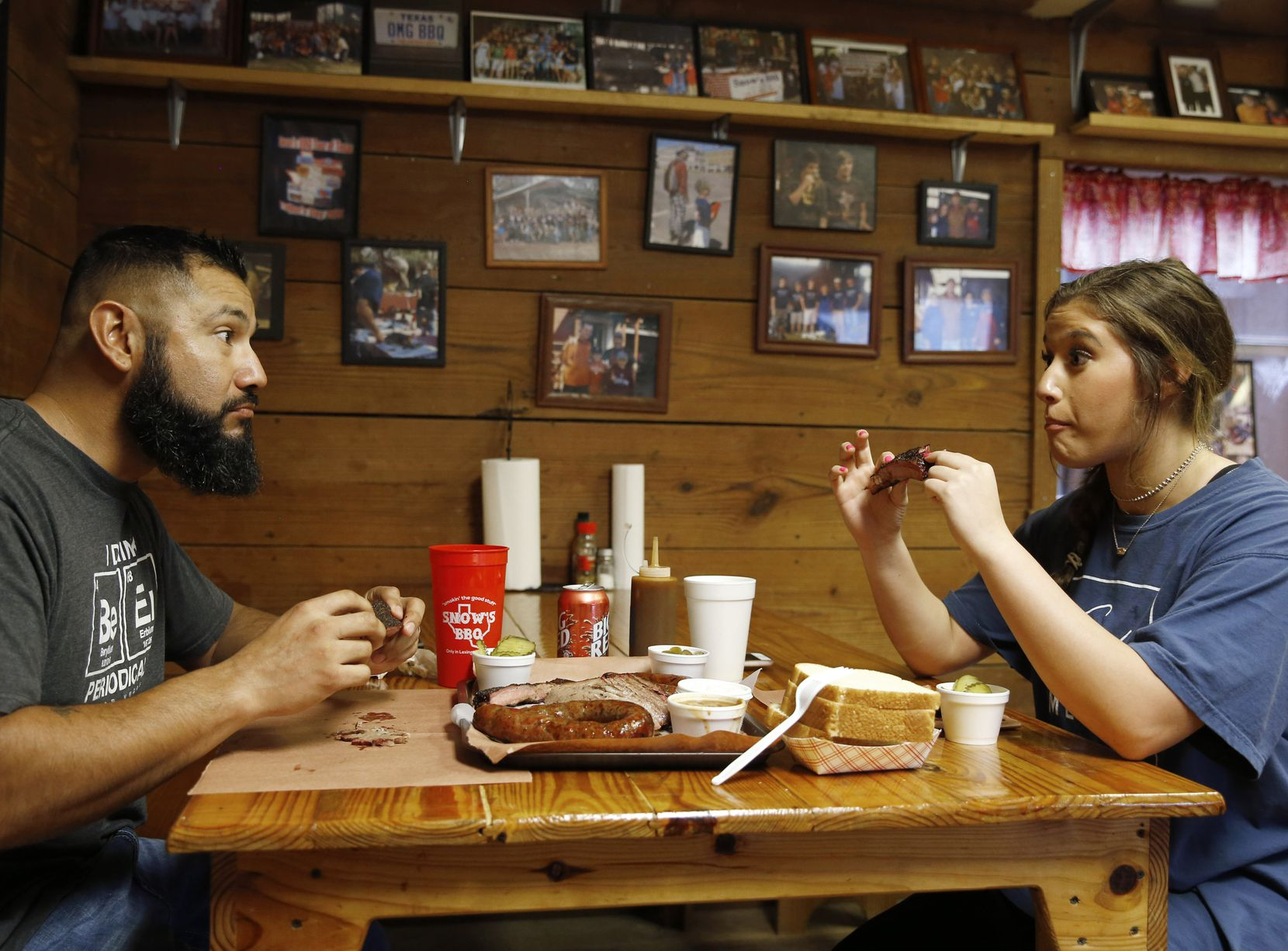 Pete and Dakota Rodriguez of Houston react after taking their first bite of a rib at Snow's BBQ. They arrived at 5 a.m. to be the first in line.