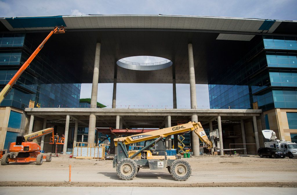 A forklift makes it's way past the front entrance of the future site of Toyota world headquarters on Thursday, October 13, 2016 in Plano, Texas. (Ashley Landis/The Dallas Morning News)