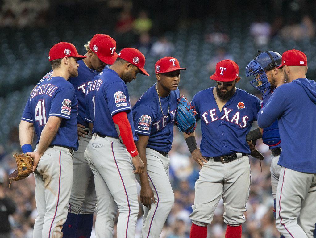 SEATTLE, WA - MAY 27:  Jose Leclerc #25 of the Texas Rangers, center, grabs at his right leg before being taken out of the game with an undisclosed injury in the seventh inning against the Seattle Mariners at T-Mobile Park on May 27, 2019 in Seattle, Washington. (Photo by Lindsey Wasson/Getty Images)