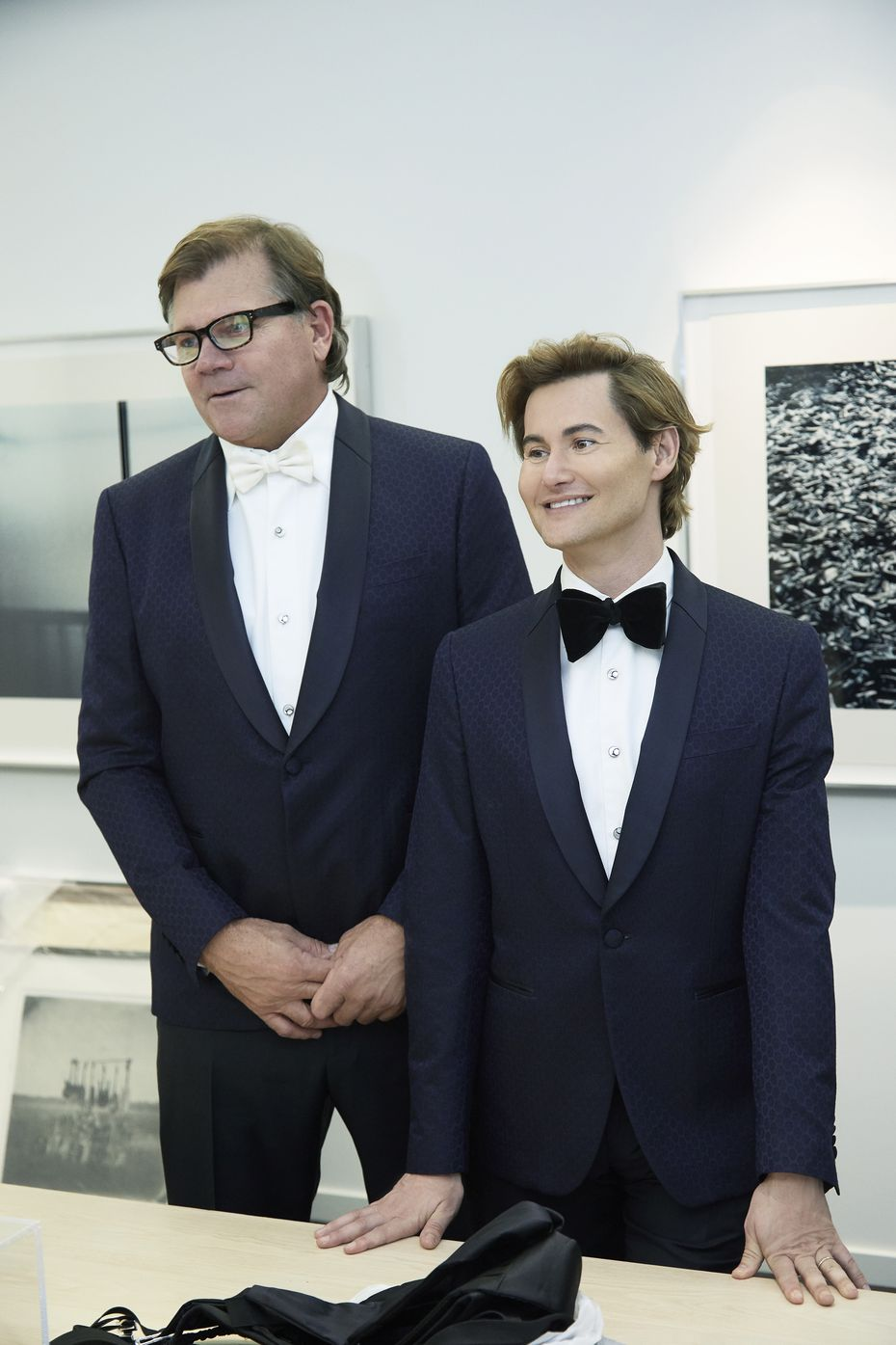The couple during their tuxedo fitting. Each wore Salvatore Ferragamo midnight blue tuxedos.