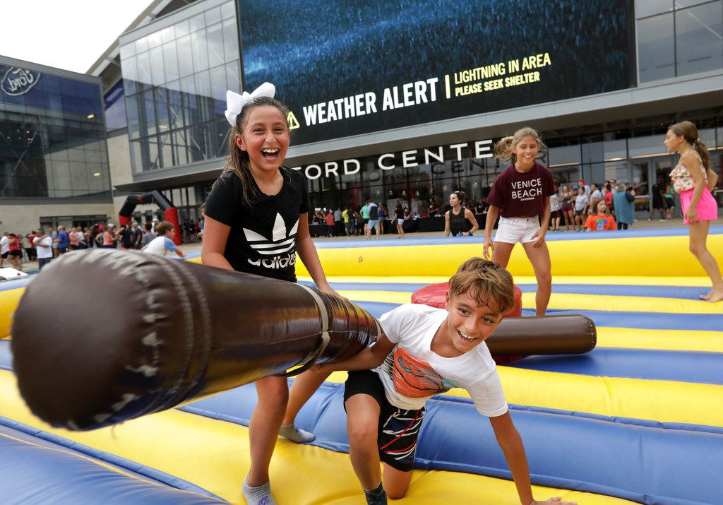 Children played during a Camp Gladiator stadium takeover event at The Star in Frisco on Aug. 18, 2018.