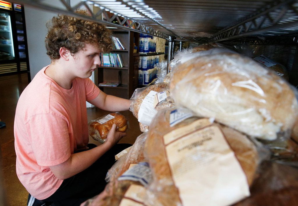 Volunteer Keegan Kasprowicz helped organize bread at Frisco Family Services Food Pantry on Thursday, July 11, 2019.