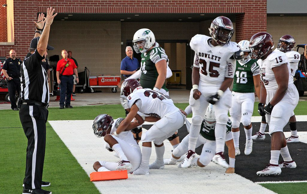 Rowlett High School defensive back Taiwan Edwards (20) scored the first touchdown at the new stadium on an pick six during the first half as Prosper High School hosted Rowlett High School in a non-district football game at Children's Health Stadium in Prosper on Friday, August 30, 2019. (Stewart F. House/Special Contributor)