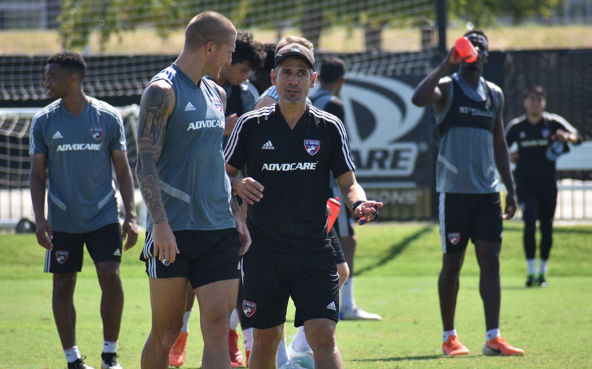 FC Dallas Head Coach Luchi Gonzalez (all black) talks to Zdenek Ondrasek after training. (7-31-19)
