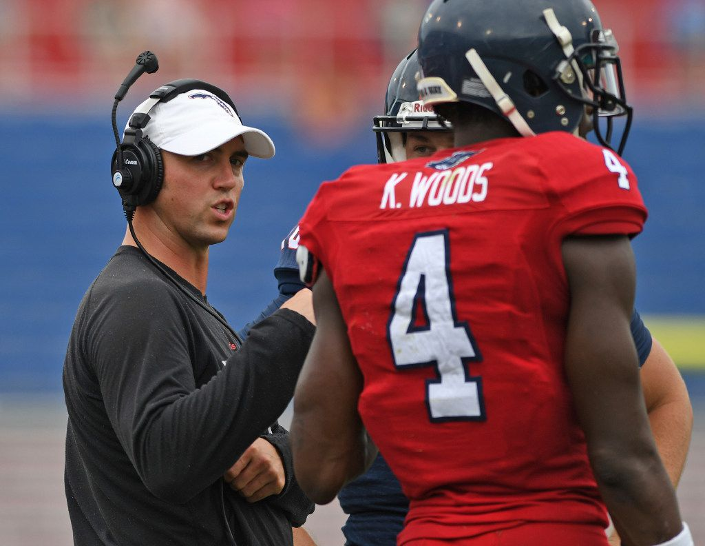 Florida Atlantic's offensive coordinator Kendal Briles takes the field for his first college football spring game at the school in Boca Raton, Fla., Saturday, April 22, 2017. Eyebrows raised when he hired Kendal Briles, the former offensive coordinator at Baylor, a program rocked by sexual assault allegations, to run his offense at FAU. (Jim Rassol/South Florida Sun-Sentinel via AP)