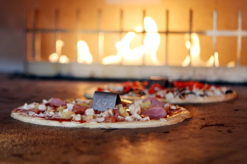 Blaze Pizza uses a hot open-flame oven to cook eleven inch thin crust pizzas, Wednesday, May 20, 2015, in Frisco, Texas. (Allison Slomowitz/ Special Contributor)