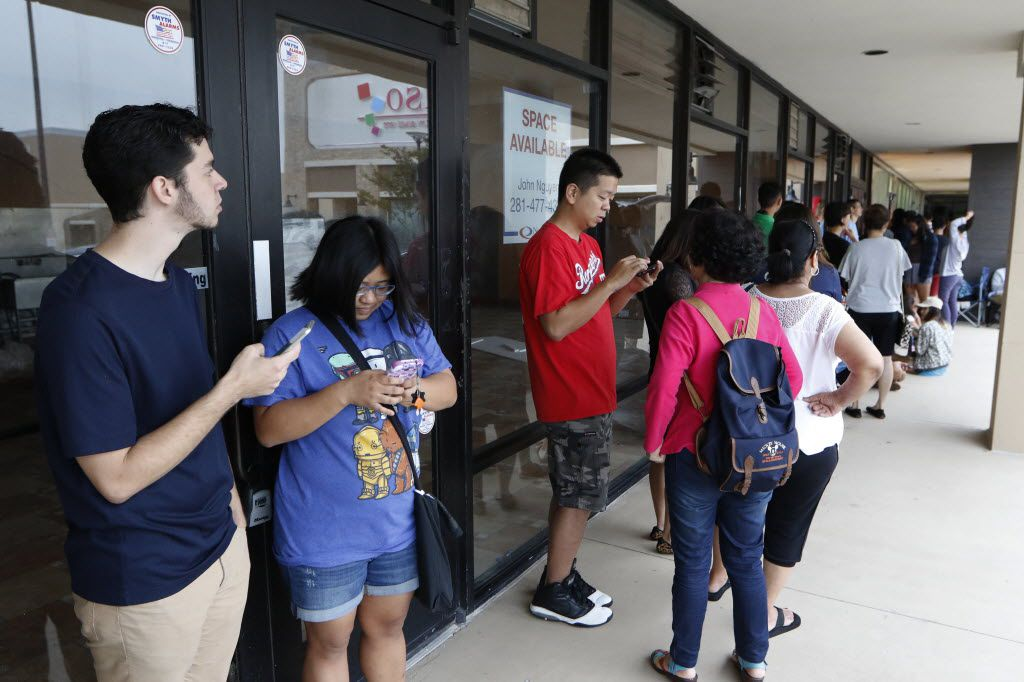 Alex Sosa, 23, left, and Vania Fung, 23, waits in line with other customers for the grand opening of 85C Bakery Cafe, a Taiwanese bakery chain, located in Carrollton, on Friday August 19, 2016. The store offers 60 types of breads, varying from Asian to European styles; plus, over 40 types of cakes. (David Woo/The Dallas Morning News)