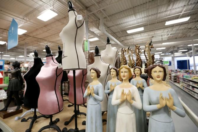 Household statuettes are shown inside the At Home on Stemmons Freeway in Lewisville. It recently changed its name from Garden Ridge.