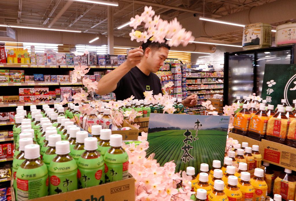 Masahio Noda, works on a unsweetened tea display at Mitsuwa Marketplace on Thursday, April 13, 2017. The grand opening will be on Friday, April 14, 2017 in Plano. It carries a wide variety of quality Japanese groceries, general items, electric appliances, cosmetics and other products in its stores. They were established in March 1998 and currently have nine stores across the United States: seven in California, one in New Jersey, and one in Chicago. Photo taken on Thursday, April 13, 2017. (David Woo/The Dallas Morning News)
