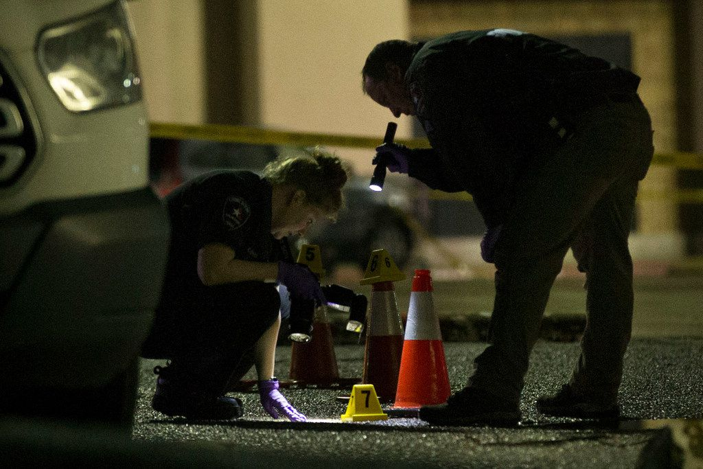 Arlington officers look for evidence at the location of an officer-involved shooting in the 1700 block of West Randol Mill Road early Saturday.