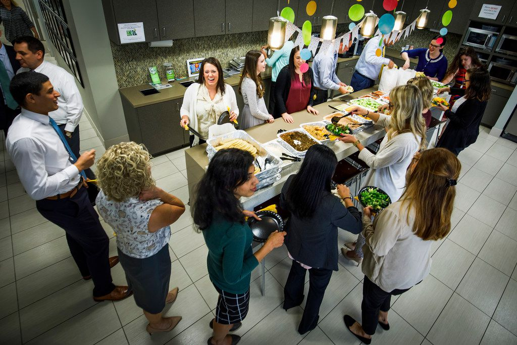 Northwestern Mutual employees fill their plates with a catered fajita lunch at their offices in Dallas.