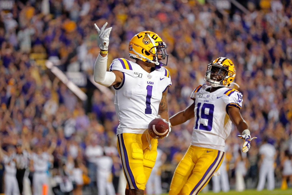 LSU wide receiver Ja'Marr Chase (1) celebrates his touchdown reception with wide receiver Derrick Dillon (19) in the first half of an NCAA college football game against Texas A&M in Baton Rouge, La., Saturday, Nov. 30, 2019. (AP Photo/Gerald Herbert)