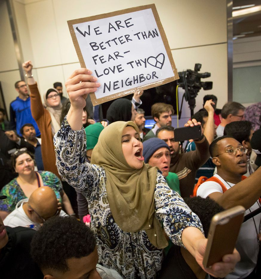 Protestors at DFW International Airport chant in opposition to President Donald Trump's executive order barring certain travelers on Sunday, Jan. 29, 2017. (Smiley N. Pool/The Dallas Morning News)