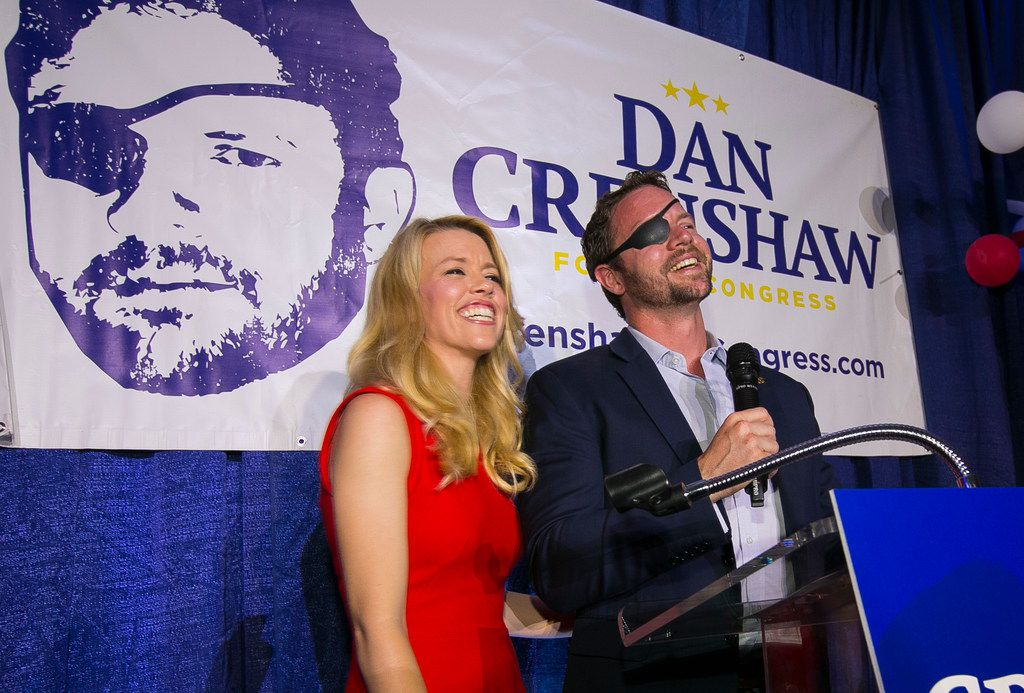 """Republican congressional candidate Dan Crenshaw, with his wife, Tara, delivered a victory speech during an election night party at the Cadillac Bar, May 22, 2018, in Houston. Crenshaw has chided """"Saturday Night Live"""" comic Pete Davidson for poking fun of the eyepatch he wears because he was badly wounded during his third tour in Afghanistan as a Navy SEAL."""
