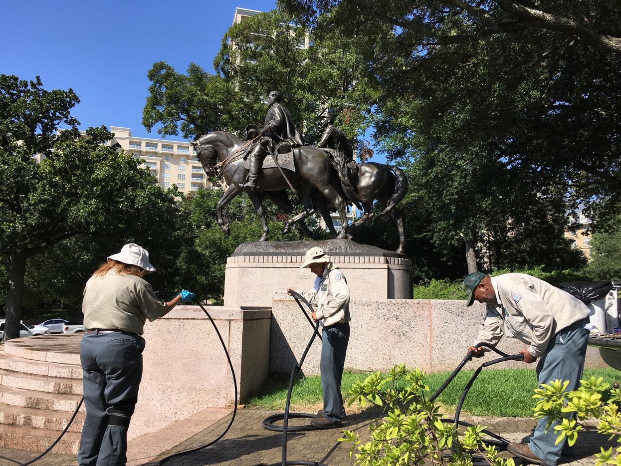 A city parks crew packed up power-washing equipment after cleaning the statue of Robert E. Lee at the Oak Lawn park named in tribute to the Confederate general.