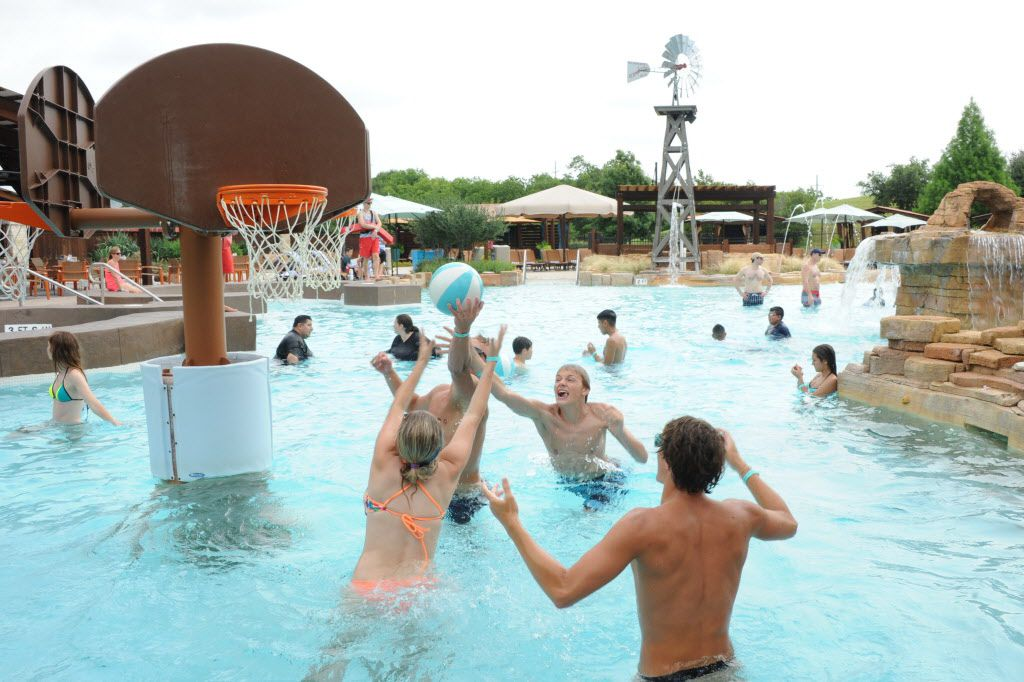 Friends play a match of water basketball at Paradise Springs at Gaylord Texan in Grapevine, TX on June 12, 2016.