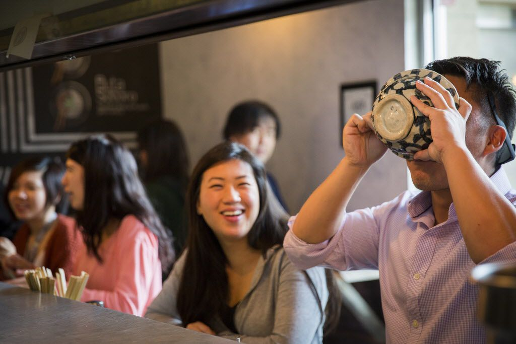 Diners at the standing-room only ramen bar