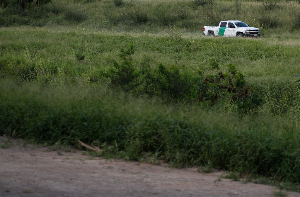 In this June 27, 2019, file photo, a U.S. Border Patrol car drives along the Rio Grande in Brownsville, Texas, as seen from Matamoros, Tamaulipas state, Mexico.