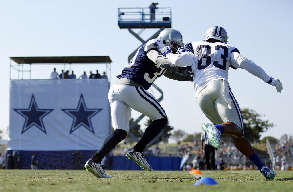 Dallas Cowboys wide receiver Terrance Williams (83) breaks away from rookie cornerback Anthony Brown (30) during afternoon practice drills at training camp in Oxnard, California, Tuesday, August 9, 2016. (Tom Fox/The Dallas Morning News)