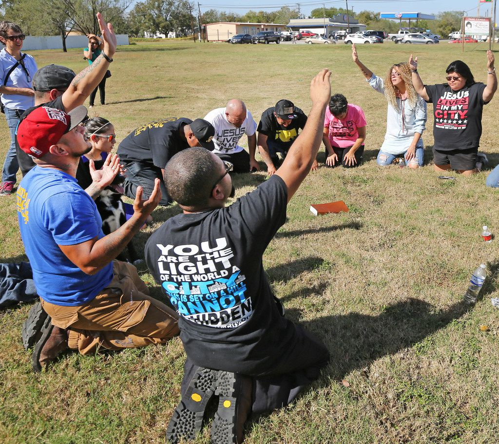 Christians pray in a field near the First Baptist Church of Sutherland Springs. At least 26 people died Sunday after a gunman opened fire at a Baptist church in the small town southeast of San Antonio. Photographed on Monday, November 6, 2017.