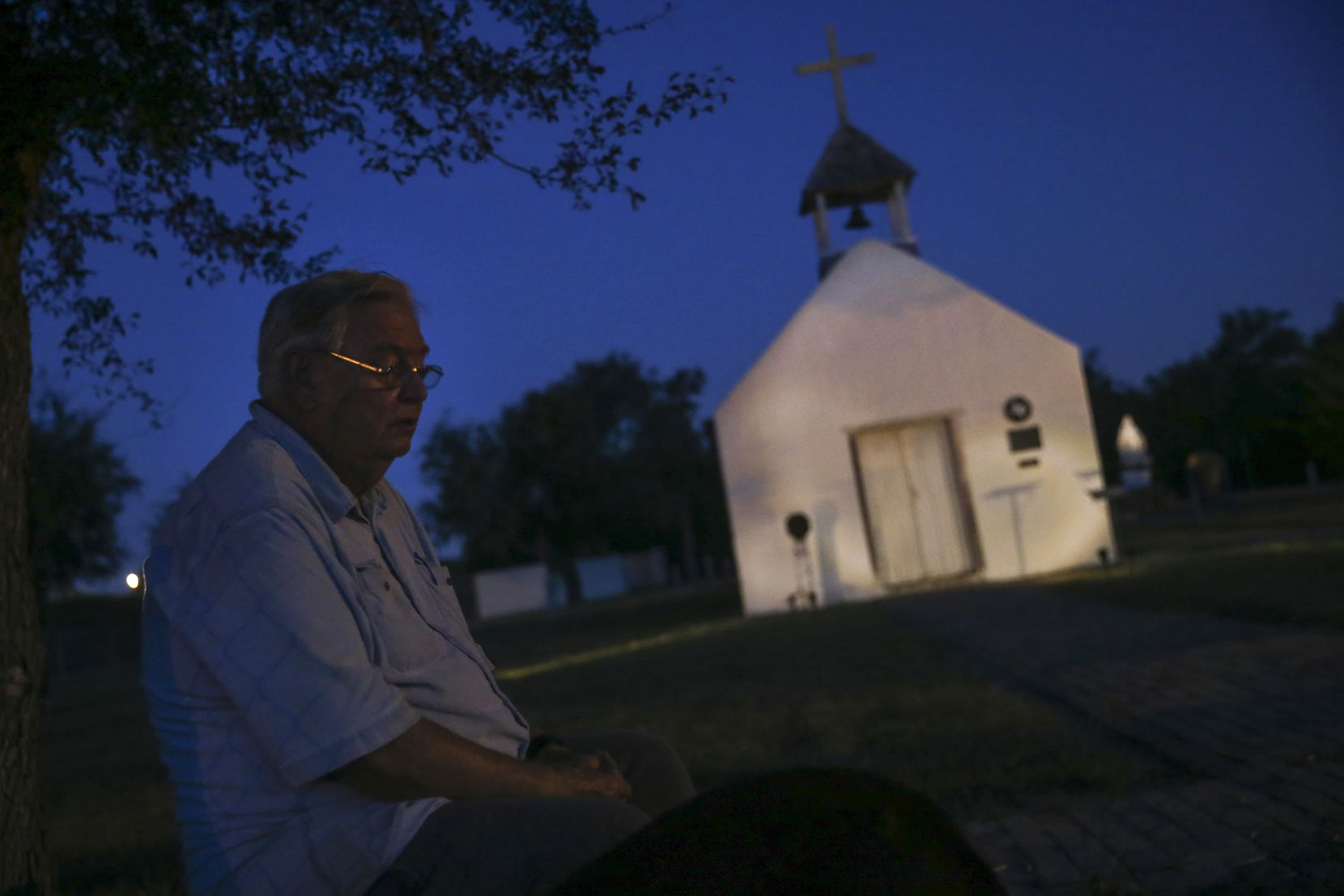 """Father Roy Snipes, commonly known as the Cowboy Priest, is pictured at La Lomita Chapel on Sunday, July 28, 2019 in Mission, Texas. The historic chapel is threatened by a border wall, which would trap the property in a """"no man's land"""" between the wall and Rio Grande."""