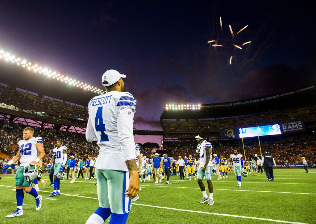 Dallas Cowboys quarterback Dak Prescott (4) walks off the field with fireworks after a 14-10 win over the Los Angeles Rams of an NFL preseason game on Friday, August 17, 2019 at Aloha Stadium in Honolulu, Hawaii. (Ashley Landis/The Dallas Morning News)