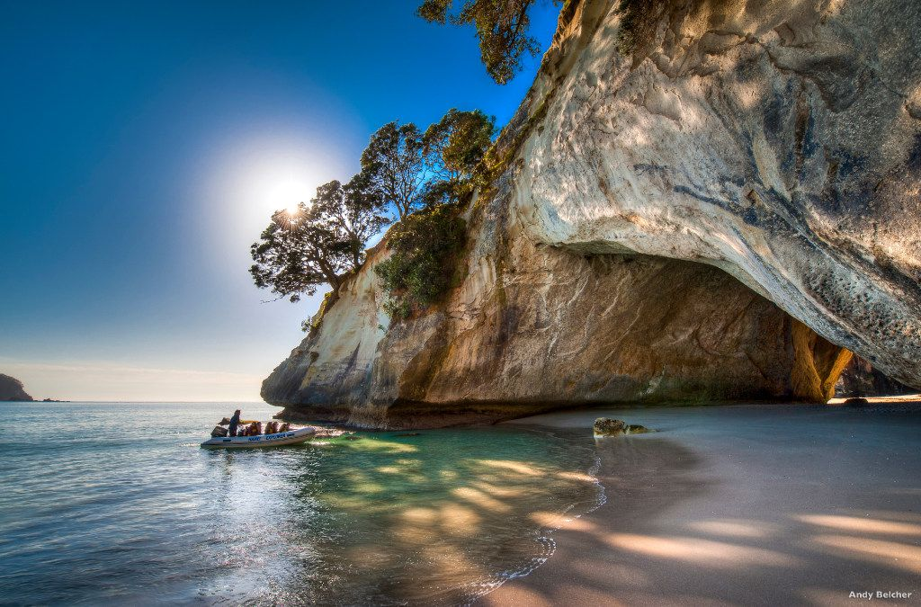 A boat heads toward the natural stone arch at Cathedral Cove on the North Island's Coromandel Peninsula.