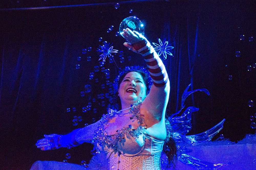 Passionata Fair catches bubbles during her performance Saturday night.
