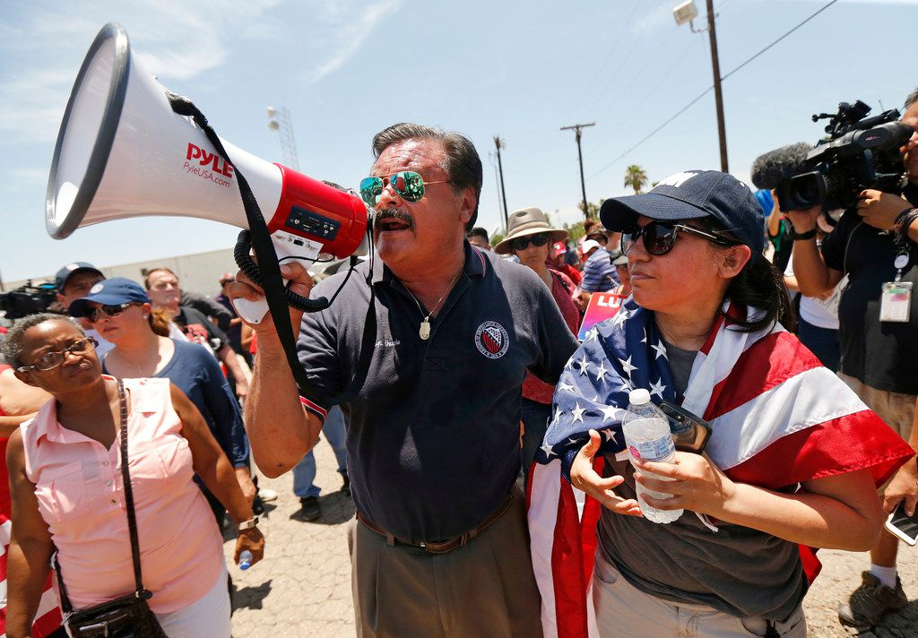 Dallas lawyer Domingo Garcia (left) leads a group of protesters outside the US Border Patrol Processing Center in McAllen, Texas, Saturday, June 23, 2018. The group was there to protest the border policies for immigrants crossing into the United States from Mexico.